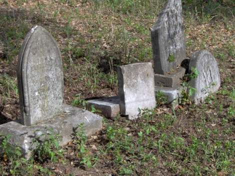 Elizabeth King, WA King, and remnants of their vandalized stones in between them. ca. 2005
